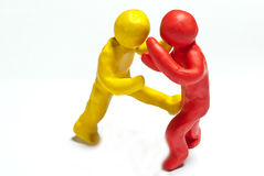 Colorful plasticine guys Stock Images