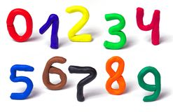 Colorful plasticine numbers set isolated on a white background. Hand made modeling clay. Stock Images