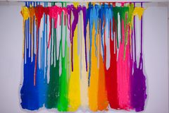 Dripping colors. Colorful of plastisol ink are dripping by in opposite directions Royalty Free Stock Photography