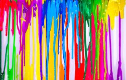 Dripping colors. Colorful of plastisol ink are dripping by in opposite directions Royalty Free Stock Photo