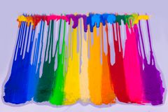 Colorful of plastisol ink dripping on white background. Colorful of plastisol ink are dripping by in opposite directions Royalty Free Stock Image