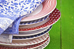 Colorful plate. Rustic and colorful plates on a green wooden table Stock Photography