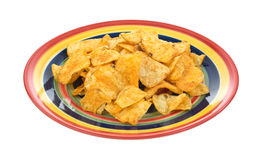 Colorful plate filled with red chili chips Stock Image