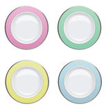 Colorful plate with gold rims on white background Royalty Free Stock Photo