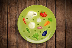 Colorful plate with hand drawn icons, symbols, vegetables and fr. Uits on grungy background Royalty Free Stock Image