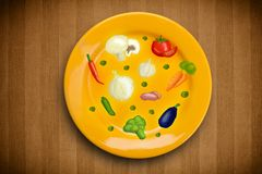 Colorful plate with hand drawn icons, symbols, vegetables and fruits. On grungy background Stock Images