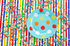 Colorful plate on striped background Royalty Free Stock Photo