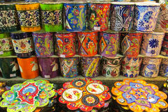 Colorful plates and cups from Asia. Souvenir plates painted with colorful flowers. Traditional arts and paintings, abstract and realistic paintings and art Royalty Free Stock Image