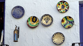 Colorful plates hanging on a wall Stock Photo
