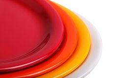 Colorful plates stacked for display Royalty Free Stock Photos
