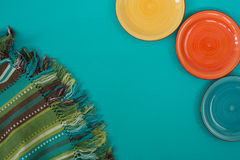 Colorful plates and striped cloth Stock Photo