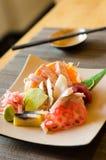 A colorful platter of sashimi sushi Stock Images