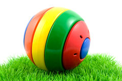 Colorful play ball on grass Royalty Free Stock Photos
