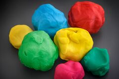 Free Colorful Play Clay Balls On A Dark Gray Background Stock Photography - 182251572