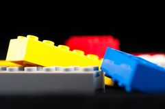 Colorful play construction bricks . Colorful play construction bricks close up shot Stock Photo