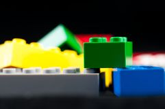 Colorful play construction bricks . Colorful play construction bricks close up shot Royalty Free Stock Images