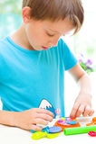 Colorful play dough. Cute little boy is playing with colorful play dough Stock Photography