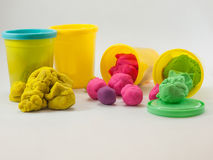 Colorful play dough. In yellow cans in white background Stock Photo