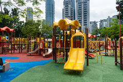 Colorful play ground structure in outdoor urban area. KUALA LUMPUR, MALAYSIA - 02 NOV 2014: Colorful play ground outdoors for children in an urban enviroment Royalty Free Stock Photos
