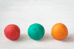 Colorful playdough balls Royalty Free Stock Photos