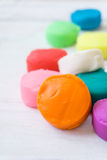 Colorful playdough on wooden table. Royalty Free Stock Photos