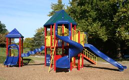 Colorful Playground. Bright Colorful playground equipment in a fall setting Royalty Free Stock Photos
