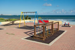 Colorful playground without children at the coast of Mediterranean sea Royalty Free Stock Images