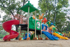 Colorful playground with children and parent Stock Images