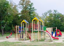 Colorful playground equipment in the park. Bright modern playground for little children. Outdoors, childhood concept. Royalty Free Stock Images