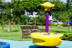 Colorful playground equipment in public park Stock Photography