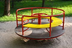 Colorful playground equipment in park. Colorful playground equipment in summer park Royalty Free Stock Image