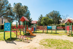 Colorful playground for kids inside a urban public park, Italy Stock Photo