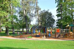 Colorful playground with swings and slides royalty free stock photo