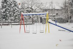 Colorful playground after winter snow Royalty Free Stock Images