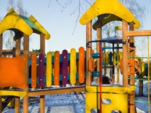 Colorful playground in wionter. Colorful wooden playground in a winter sunny day Royalty Free Stock Photography