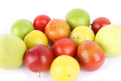 Colorful plums fruit. With white background royalty free stock images