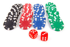 Colorful poker casino chips and red dices Stock Photo