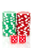 Colorful poker chips and dices. A pair of dices and stacks of colorful poker chips Stock Images