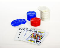 Colorful poker chips and face cards from a deck Royalty Free Stock Photography