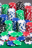 Colorful poker chips on a green felt Stock Photo