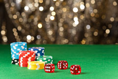 Colorful poker chips and red dice Stock Photos