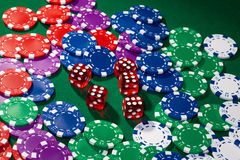 Colorful poker chips and red dice Stock Photography