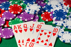 Colorful poker chips and royal flush Royalty Free Stock Photos