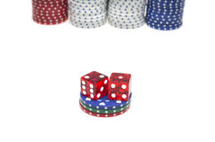 Colorful poker chips with two red dice isolated Royalty Free Stock Photo