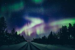 Colorful polar arctic Northern lights Aurora Borealis activity in winter Finland stock image