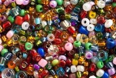 Colorful polished glass beads. Background, macro Stock Photos