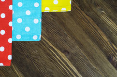 Colorful polka dot napkins on wooden background. Stock Photo
