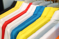 Colorful polo shirt on a hanger Royalty Free Stock Images
