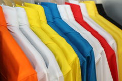 Colorful polo shirt on a hanger Royalty Free Stock Photos