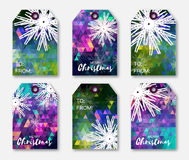 Colorful polygonal Festive collection of Christmas labels with snowflakes. Royalty Free Stock Image